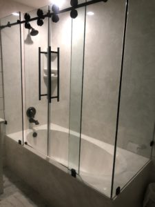 Cultured Marble Shower Walls, Bathtub, Bypass Glass Enclosure with a Running Rail and Rollers