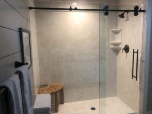 Cultured Marble Shower Walls, Shower Pan, Bypass Glass Enclosure with a Running Rail and Rollers